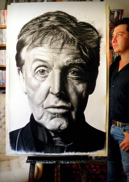 Alberto with his painting of Sir Paul McCartney