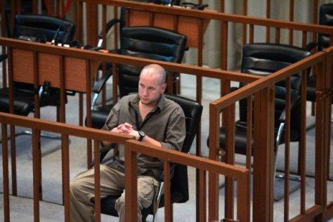 Denn in Saddam's seat at Trial in Baghdad