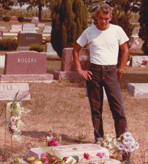 Roy Phillips stands at James Dean's grave